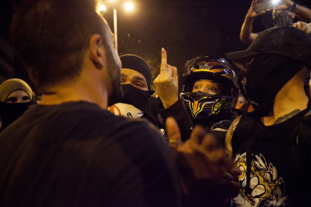 A fascist or infiltrator rebukes the protesters during the sixth consecutive night of riots in Barcelona against the sentence of the trial of the process. October 19, 2019.