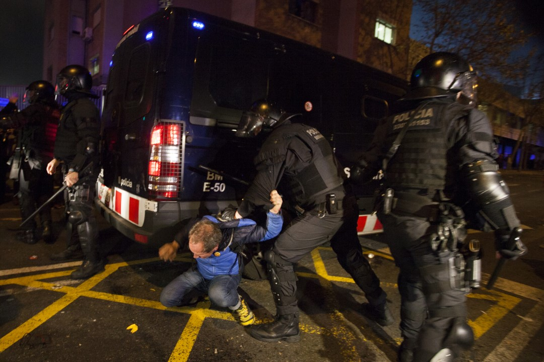 A protester is beaten by the police during the demonstrations at the Camp Nou. Barcelona; December 18, 2019.
