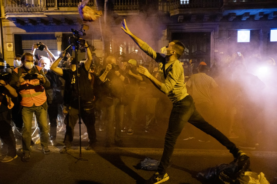 A protester throws a pig's head at the police during protests against the disqualification of the President of the Generalitat Quim Torra. Barcelona; September 28, 2020.