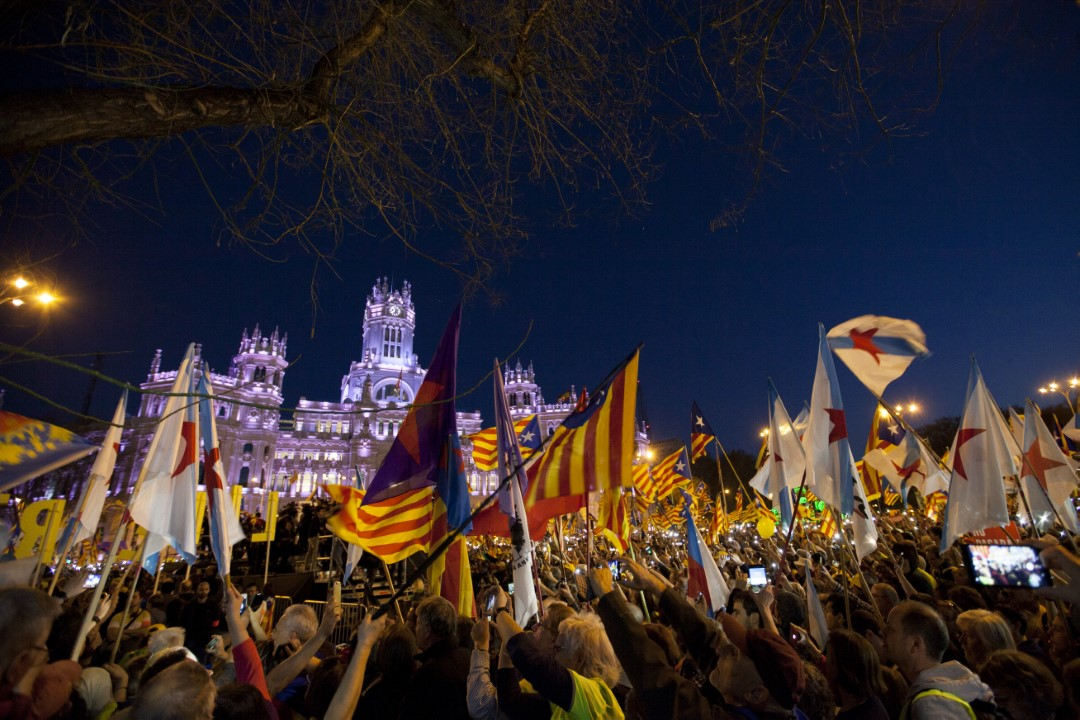 """Thousands of people gather in the Plaza de Cibeles in Madrid against the October 1 trial of the Supreme Court. Under the slogan """"Self-determination is not a crime. Democracy is deciding"""". Madrid Spain; March 19, 2019."""