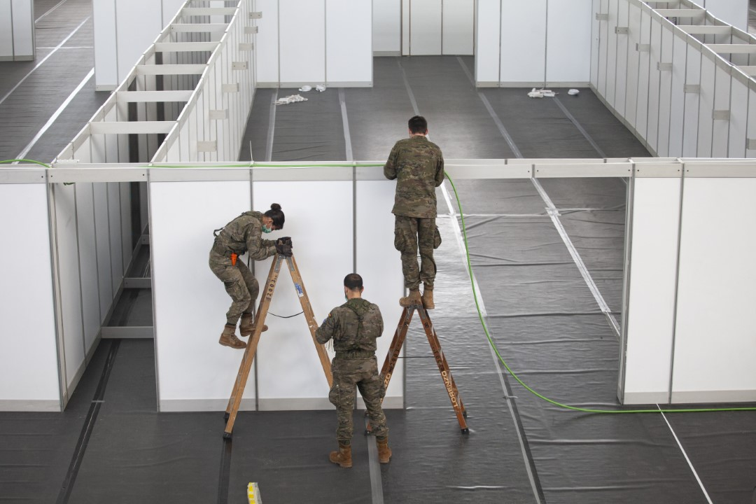 Military members setting up the Vallès Salud temporary hospital within the Indoor Athletics Track of Catalonia. March 31, 2020; Sabadell, Barcelona.