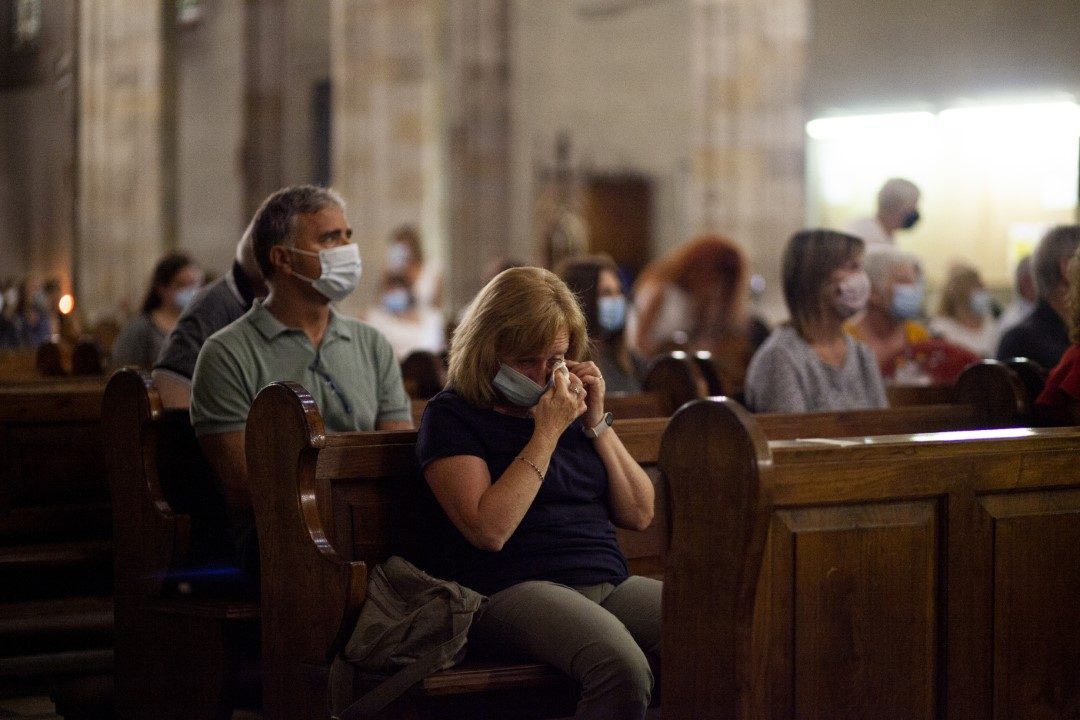 A woman mourns the loss of a deceased relative of Covid-19 and a resident of the Vivaldi Geriatric Center. Fifty relatives joined St. Felix's Church to say goodbye to the 14 grandparents of the Vivaldi residence who lost their lives during the pandemic. July 9, 2020, Sabadell, Barcelona.