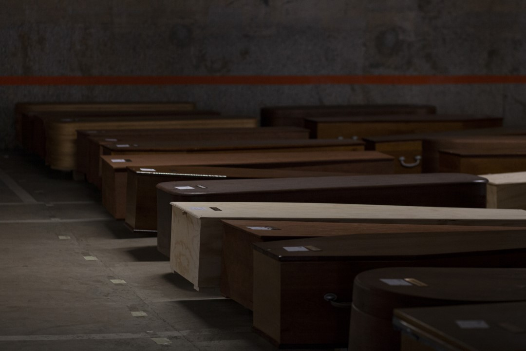 The Collserola Mortuary of the Mémora funeral home, has had to enable and air-condition its car park as a morgue due to lack of space. Inside this underground car park are, today, about 500 coffins, most of them with the bodies of the victims, waiting to be buried or cremated. April 16, 2020; Collserola, Barcelona.