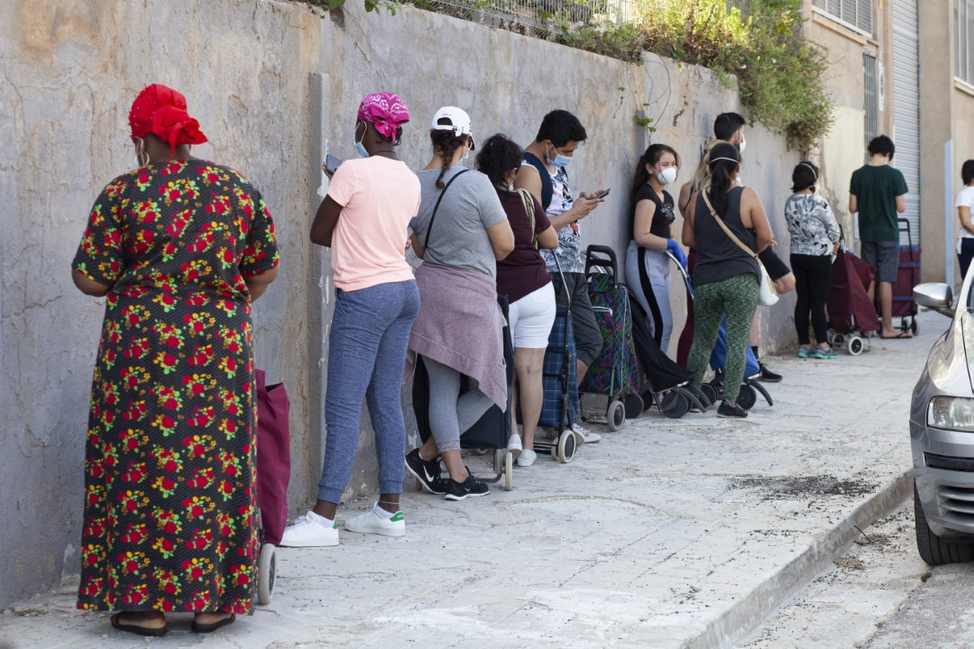Queues to collect food at the Christian Family Center. Consequences of the pandemic. May 22, 2020; Sabadell, Barcelona.