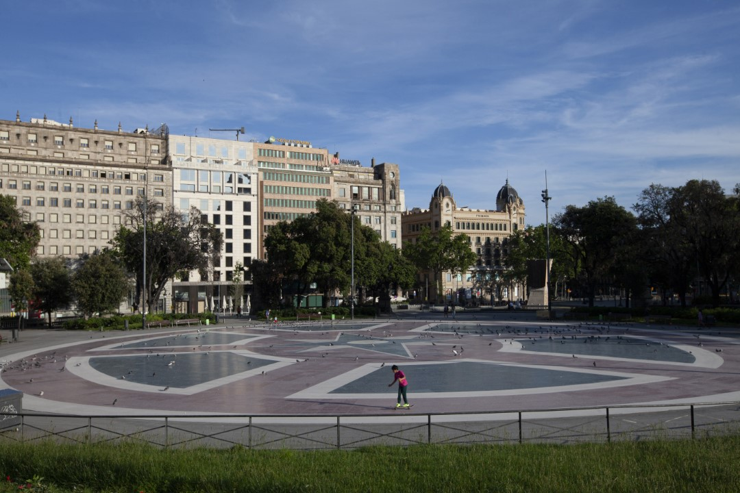 A child skates alone in Plaza Cataluña of Barcelona, one of the busiest squares in this city, on the first day of discontent due to time slots. May 2, 2020. Barcelona.