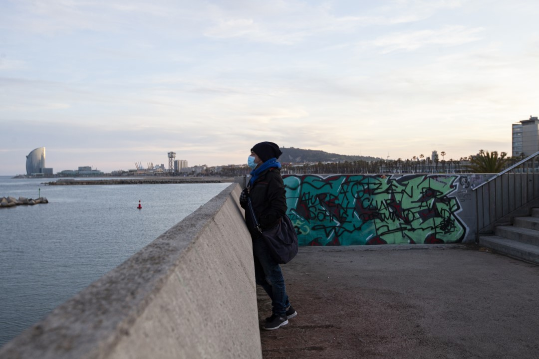 A man observes the sea during the time frame 14-70 age, after 7 weeks closed to combat Covid-19. May 2, 2020. Barcelona.